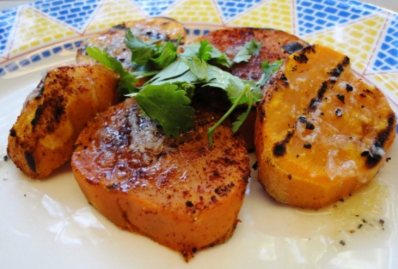 Spoon dressing over the grilled sweet potato and garnish with chopped ...